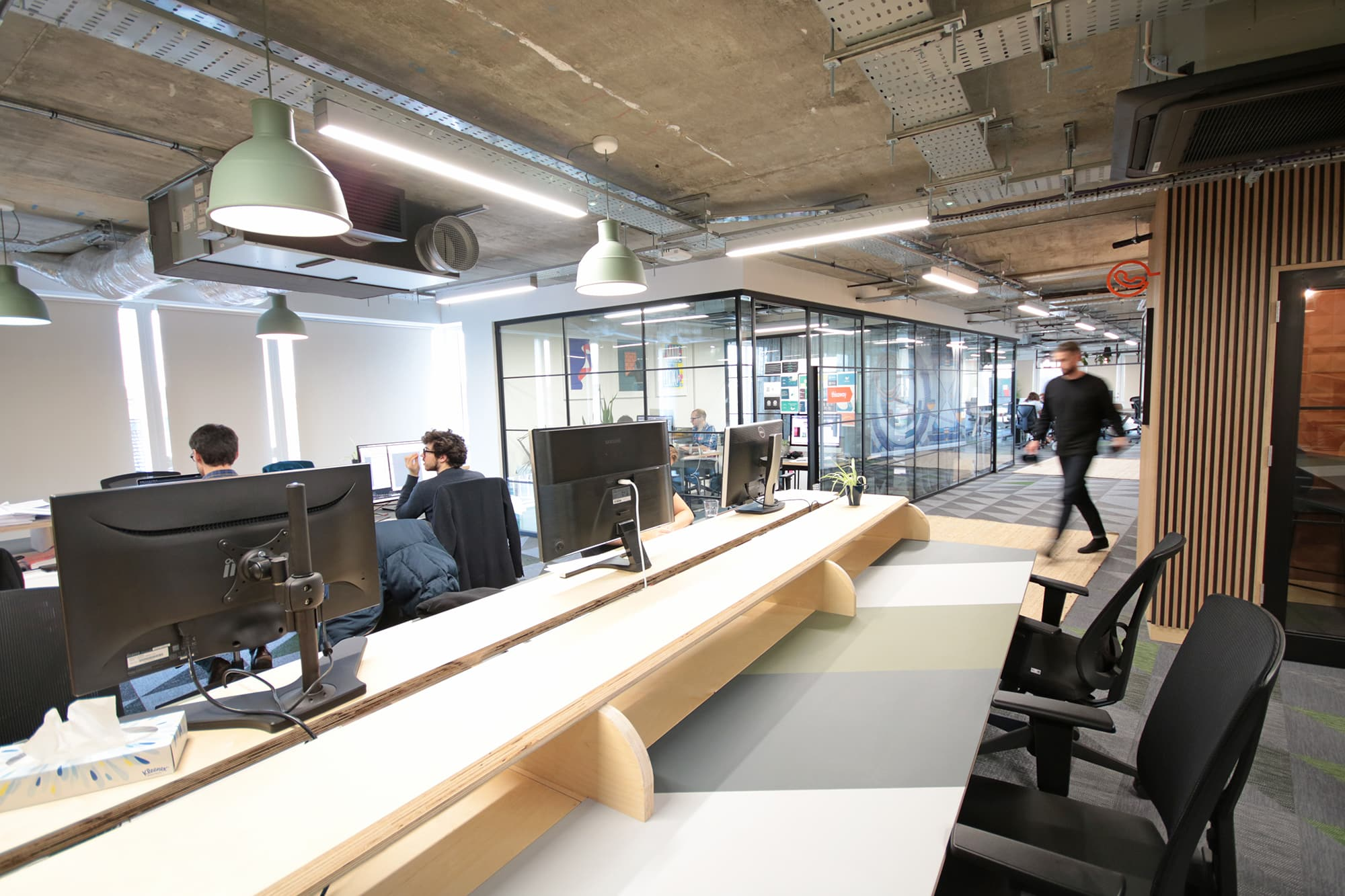 Coworking space with man walking