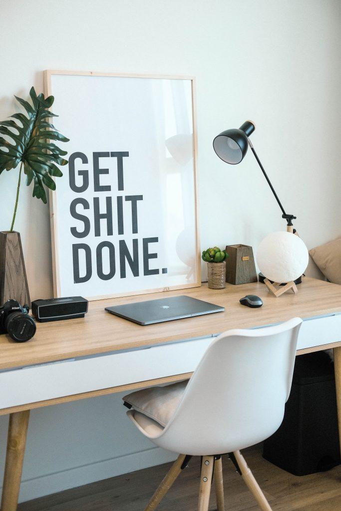 Desk and chair with sign saying 'get shit done'