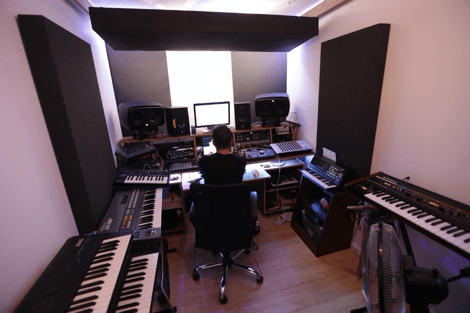 man in music studio in east london