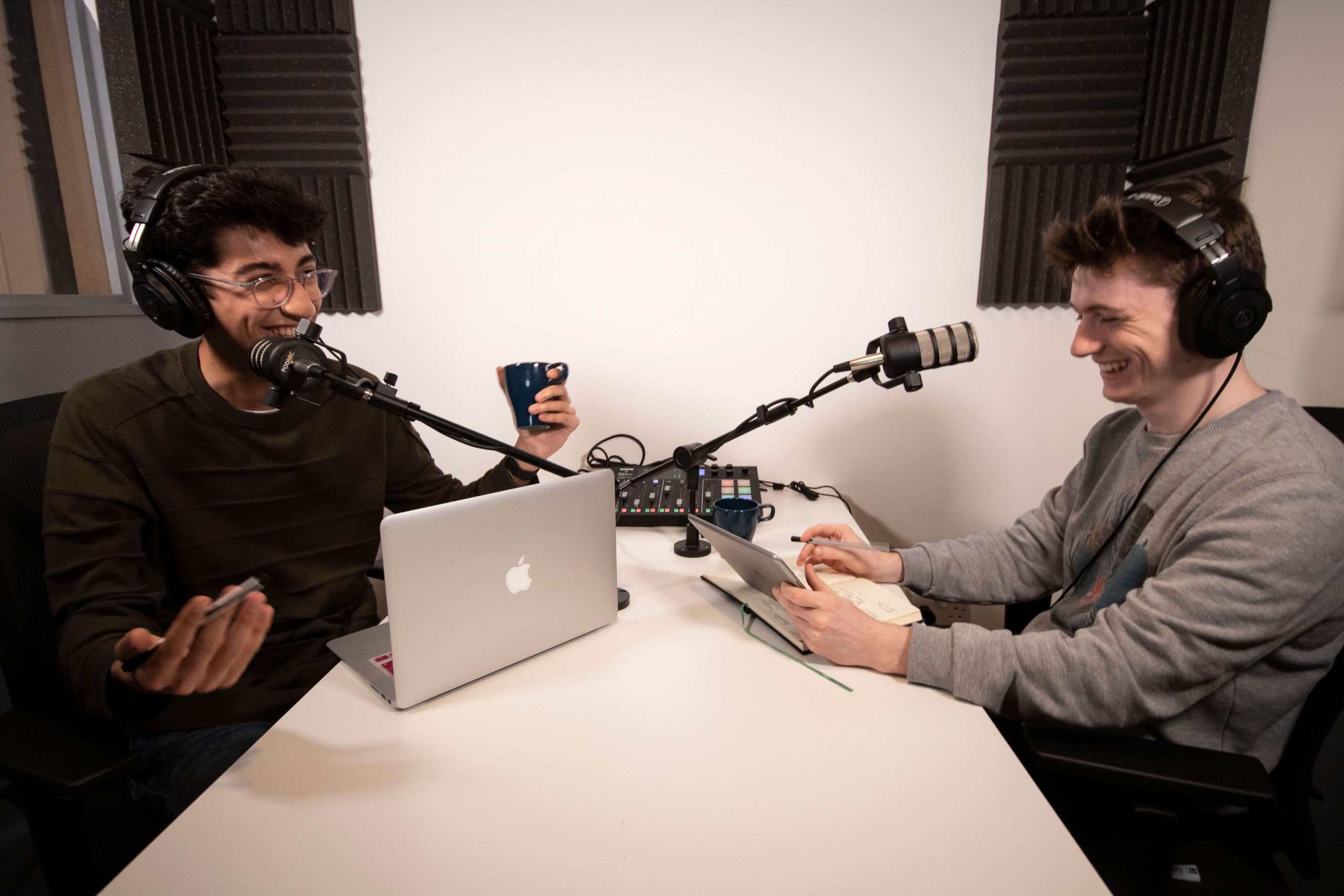 2 young guys podcasting in studio