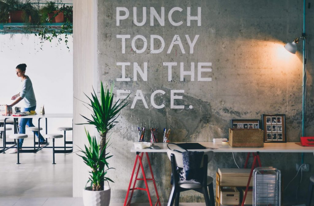Commercial Office Space with sign on wall written Punch today in the face